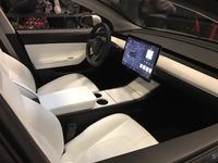Silver-Tesla-Model-3-interior-cupholder-touchscreen